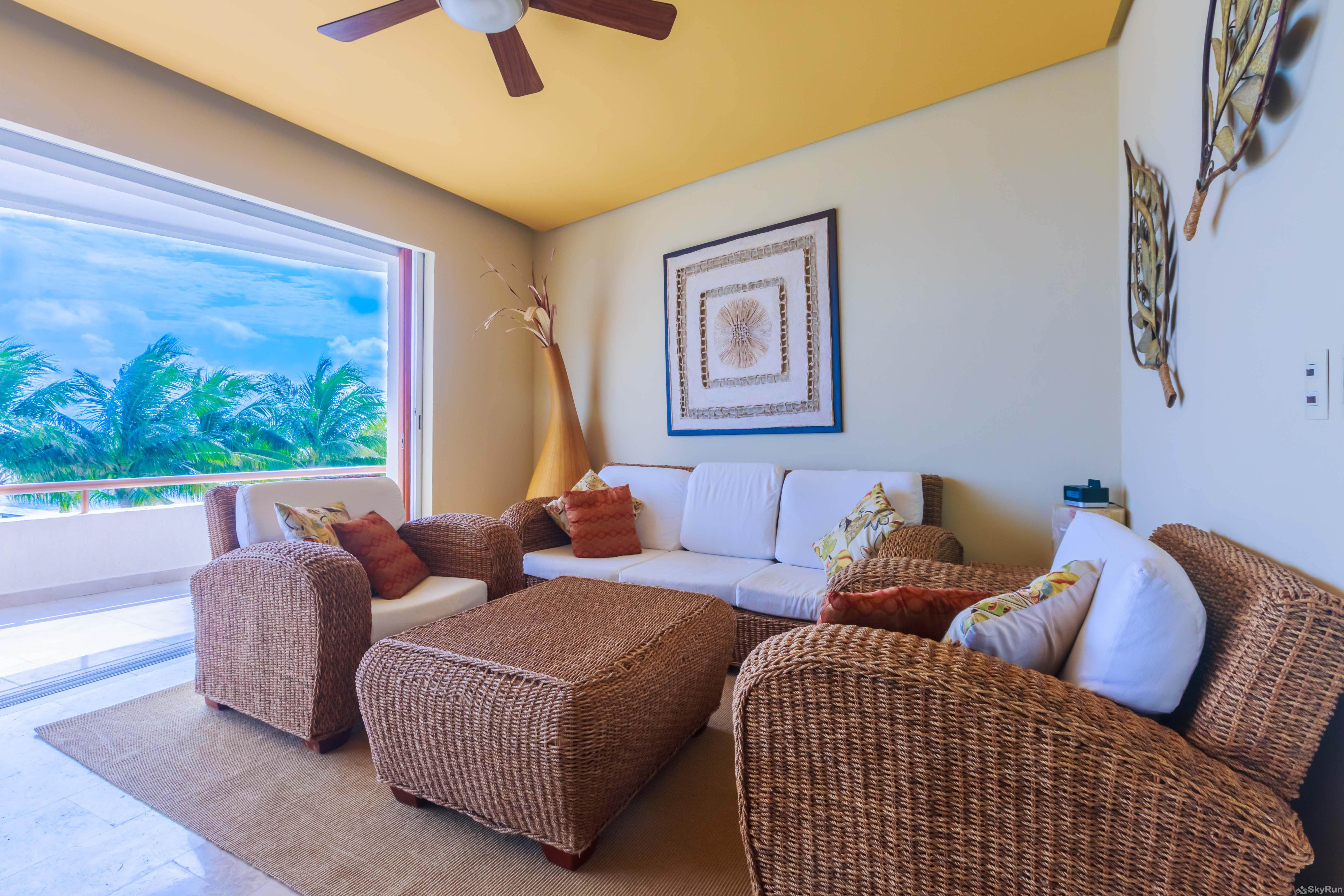 Coral Three Bedroom Oceanfront Residence Living and dinning area totally equipped with Oceanview
